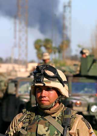 A U.S. soldier from the 173rd Airborne Division, guards oil facilities in the oil-rich northern city of Kirkuk, April 11, 2003. The United States plans to run Iraq's oil industry until an Iraqi interim authority can be formed to take it over, sources familiar with the evolving plan said. Photo by Nikola Solic/Reuters