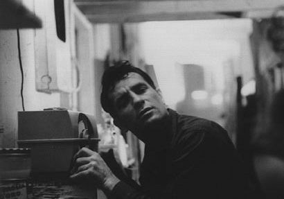 Mr. Kerouac listening to the radio.